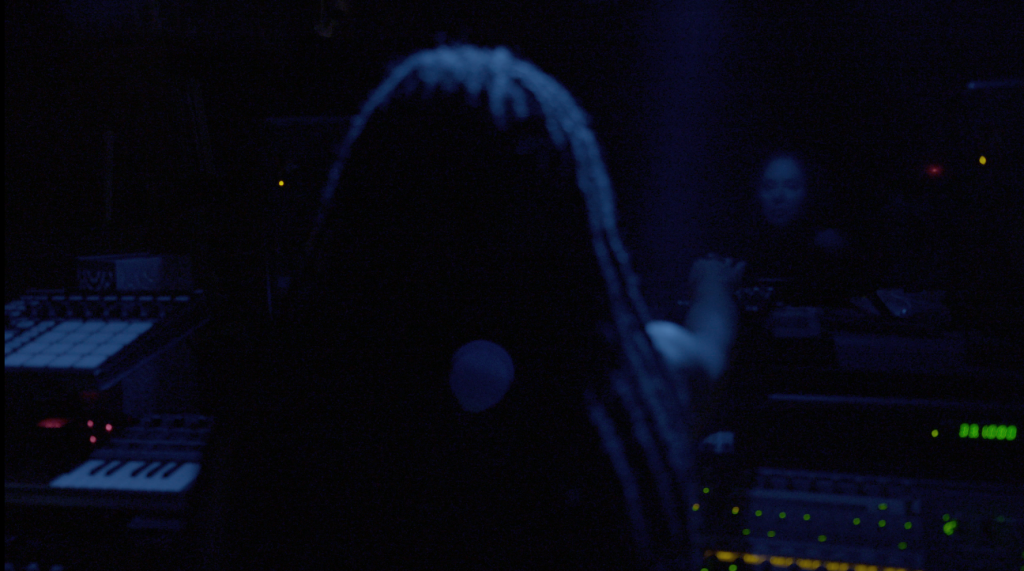 The Angel reaching over mixing desk / reflection